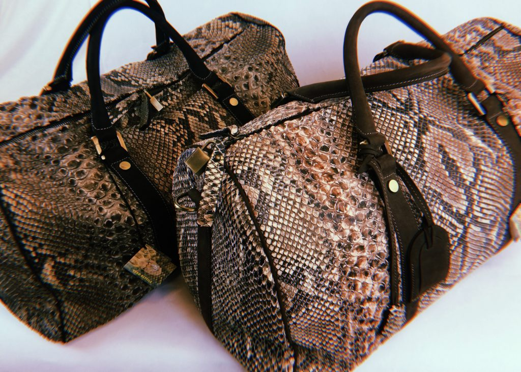 Luxury python travel bags by GLENI