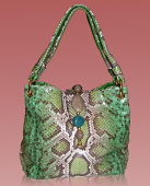 Woman python handbag in emerald green tonality with stones decorations