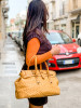 Handbag made of genuine ostrich leather in deep warm yellow colour by GLENI