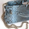 pochette in genuine python leather in sky blue color