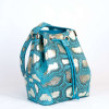 Turquoise bucket bag with shiny details