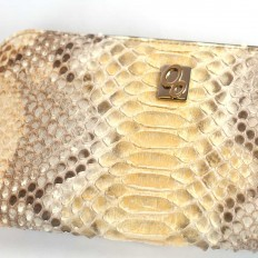 Details of python leather in gold Nilo Oro color