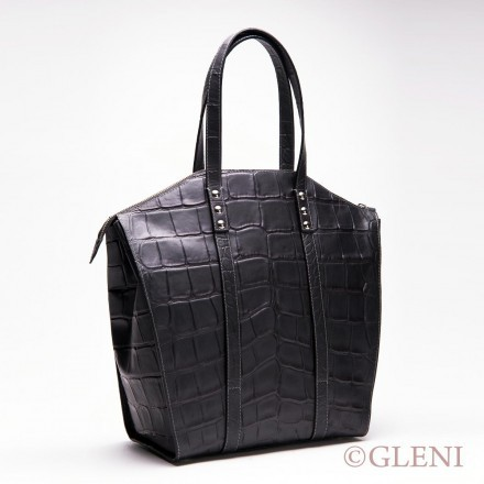 Embossed leather handbag with practical handles in black color