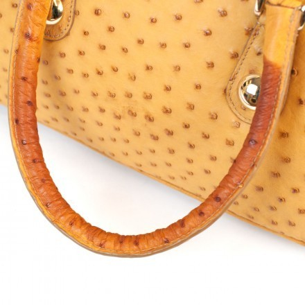 Stains on the handles of the discounted ostrich handbag