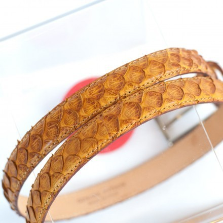 Woman's belt in genuine ocher colored python