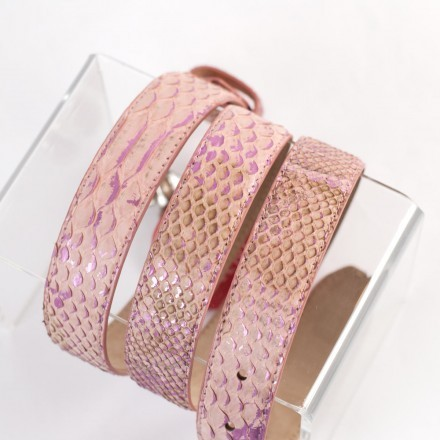 Bright pink leather belt with gem-encrusted buckle