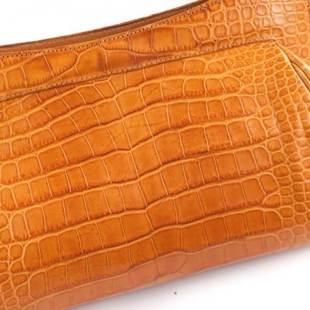"Details of the ""La Classica"" clutch in genuine alligator"